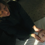 Jennifer Kellow, RN, performing Alexander Technique on a baby
